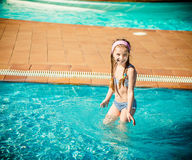 Happy gir in the pool Royalty Free Stock Images