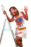 Happy gir smeared in paint. Happy girl makes painting, she is all smeared in paint Royalty Free Stock Photography