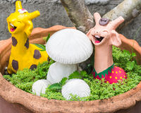 Happy giraffe with mushrooms clay in pot Stock Images