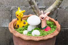 Happy giraffe with mushrooms clay in  pot Royalty Free Stock Image