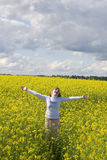 Happy girl. In flowers land Royalty Free Stock Image
