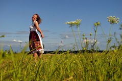 Happy Girl. Girl is laugh and going round in field and look to You! She is smiling to you, and wind blows about her hairs Stock Images