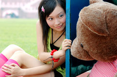 Happy girl. Chinese beautiful girls and teddy bear Stock Photography