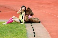 Happy girl. Chinese beautiful girls and teddy bear Stock Image