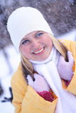 Happy girl. Portrait of the young happy girl under a falling snow Royalty Free Stock Photos
