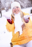 Happy girl. Young happy girl plays with a snow Royalty Free Stock Images