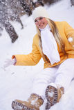 Happy girl. Young happy girl plays with a snow Royalty Free Stock Photography