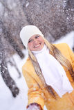Happy girl. Portrait of the young happy girl under a falling snow Stock Photo