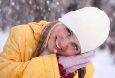 Happy girl. Portrait of the young happy girl under a falling snow Royalty Free Stock Images