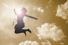 Happy girl. Jumps in the clouds Stock Image