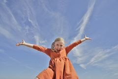 Happy girl. Against a blue sky stock photo
