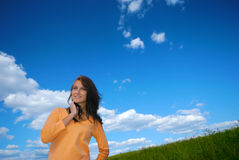 Happy girl. Over bright blue sky Royalty Free Stock Images