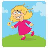 Happy girl. Running over a grass field Royalty Free Stock Images