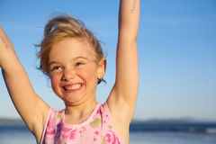 Happy girl. A happy girl throwing her arms into the air Stock Images