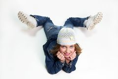 Happy girl. Happy teenager girl lying down, wearing casual clothes Stock Image