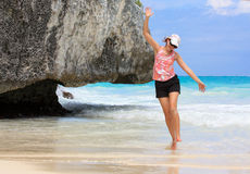 Happy girl. A young girl running happily at the beach in the caribbean Royalty Free Stock Photos