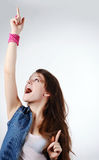 Happy girl. Happy young teenager girl on grey background Stock Photos