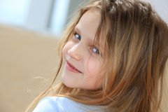 Happy girl. Portrait of a beautiful little girl looking back and smiling Stock Photo