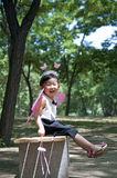 A happy girl. Sit in forest Royalty Free Stock Photo