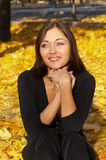 The happy girl. In autumn park Royalty Free Stock Image