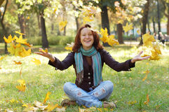 Happy  girl. Rests in an autumn park Royalty Free Stock Photos