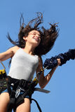 Happy girl. Girl having a good time bungee jumping Royalty Free Stock Photo