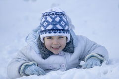 Happy girl. On snow Stock Images