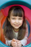 Happy girl. Happy child on playground Royalty Free Stock Image