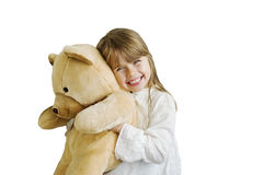 Happy girl. Cute smiling girl is holding teddy bear Royalty Free Stock Photos
