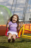 Happy girl at an amusement park. Girl at an amusemant park Stock Images