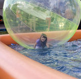 Happy girl at an amusement park. Girl at an amusemant park with ball and water Stock Image