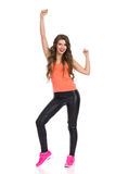 Happy Girl With Arm Raised Royalty Free Stock Photos
