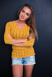 Happy girl with arms folded Royalty Free Stock Photography