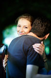 Happy girl in the arms of her fiance Stock Images