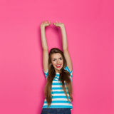 Happy Girl With Arms Raised Against Pink Background Royalty Free Stock Photos