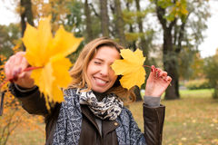 Happy girl in autumn forest colorful leaves Royalty Free Stock Photo