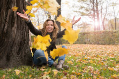 Happy girl in autumn forest colorful leaves Stock Photography