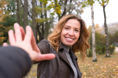 Happy girl in autumn forest colorful leaves Stock Image