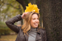Happy girl in autumn forest colorful leaves Stock Photos