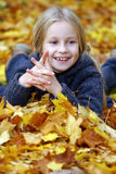 Happy girl in Autumn leaves Stock Images