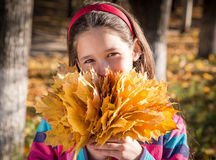 Happy girl with autumn leaves Stock Photo