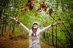 Happy girl with autumn leaves Royalty Free Stock Images