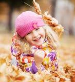 Happy girl at autumn Stock Photo