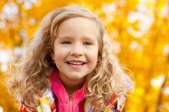 Happy girl in autumn Royalty Free Stock Photos