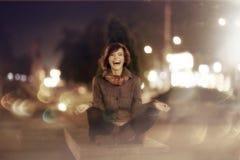 Happy girl in autumn night city Stock Image