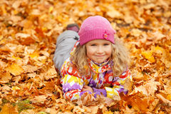Happy girl in autumn park Stock Images