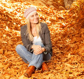 Happy girl in autumnal park Stock Image