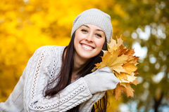 Happy woman on a background of autumn trees Royalty Free Stock Photography