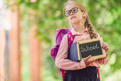 Happy girl with a backpack outdoors royalty free stock image