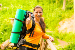 Happy girl with a backpack Stock Images